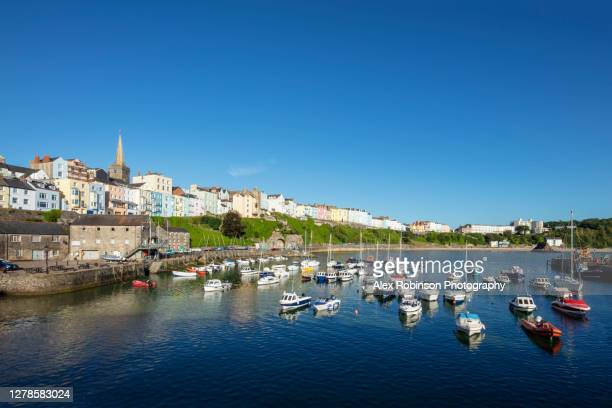 view of tenby town and harbor - carmarthen bay in pembrokeshire, wales - coastline stock pictures, royalty-free photos & images