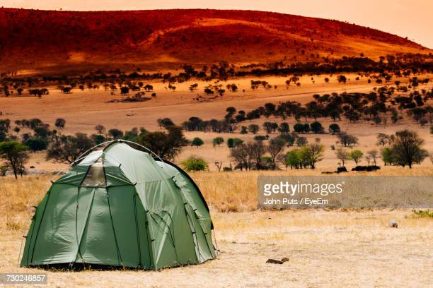 View Of Tent On Landscape During Sunset