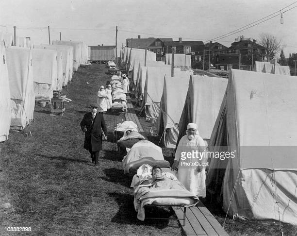 View of tents and patients at an emergency hospital in Brookline to care for the influenza cases Massachussetts October 1918