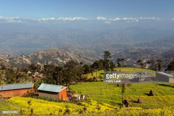 View of terraced fields and the mountains of the Himalayas, at Nagarkot, Nepal