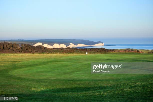 View of the 15th green with the 'Seven Sisters' cliffs in the background at the Seaford Head Golf Course on March 30, 2021 in Seaford, England. Golf...
