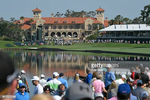 View of the 18th green and clubhouse during the first round of THE PLAYERS Championship on THE PLAYERS Stadium Course at TPC Sawgrass on May 10 in...