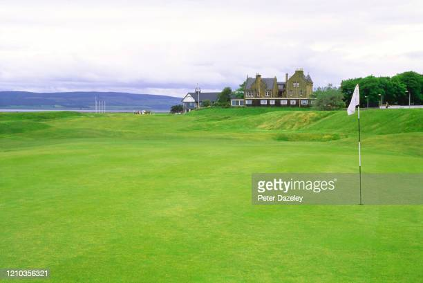 View of the 1st Green on 1st hole at Royal Dornoch golf club with with Clubhouse in background in Dornoch, Scotland.