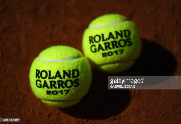 View of the 2017 Roland Garros balls ahead of the Roland Garros 2017 French Tennis Open on May 26 2017 in Paris / AFP PHOTO / GABRIEL BOUYS