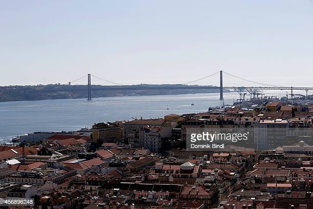 View of the 25 de Abril Bridge between Lisbon and Almada which spans the Tejo Riverl seen from Sao Jorge Castle on August 28 2014 in Lisbon Portugal