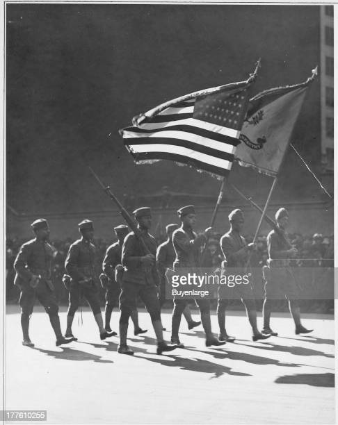 View of the 367th Regiment Infantry the 'Buffaloes' as they march up Fifth Avenue New York City with the colors presented by the Union League Club of...