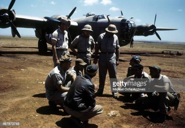 A view of the 389th Bombardment Group sitting around a B24 Liberator at the US Air Force base in Benghazi Libya