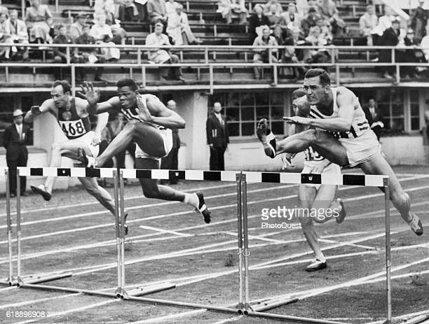 View of the 4th heat of the 110meter hurdles event of the Men's Decathlon in Helsinki Olympic Stadium during the Games of the XV Olympiad Helsinki...