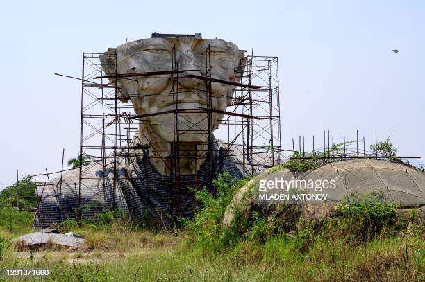 View of the abandoned giant sculpture of a Buddhist monk in Cha-am outside Hua Hin, 145km south of Bangkok, on February 25, 2021.