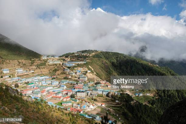 view of the accommodation and sherpa house in namche bazaar village, nepal. - solu khumbu stock pictures, royalty-free photos & images