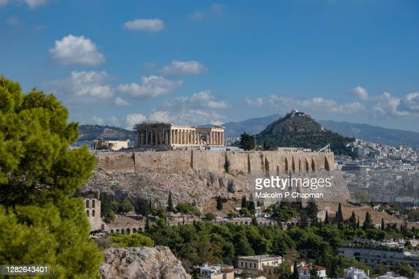 view of the acropolis and parthenon temple from filopappou hill, athens, greece - アテネ ストックフォトと画像