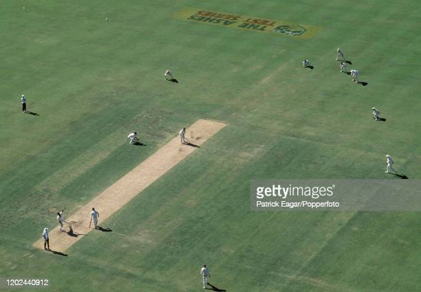 A view of the action from a floodlight tower as Devon Malcolm of England bowls to Mark Taylor of Australia during the 5th Test match between...