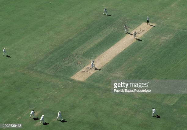 A view of the action from a floodlight tower as England batsman Chris Lewis drives a delivery from Glenn McGrath of Australia during the 5th Test...