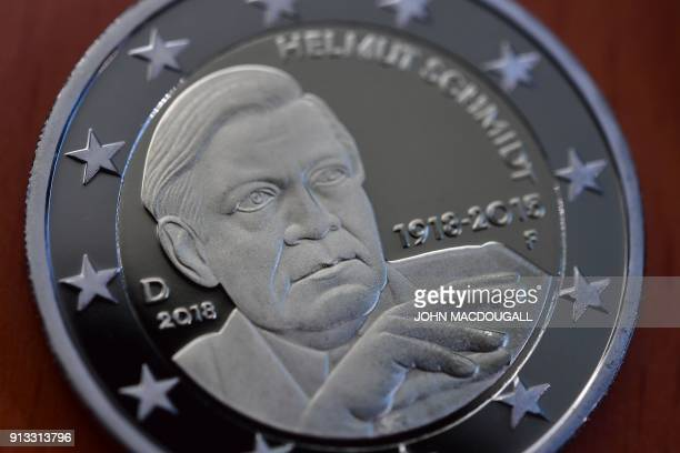 A view of the actual coin featuring Helmut Schmidt during the presentation of two commemorative 2eurocoins called 'Berlin' and '100th birthday of...