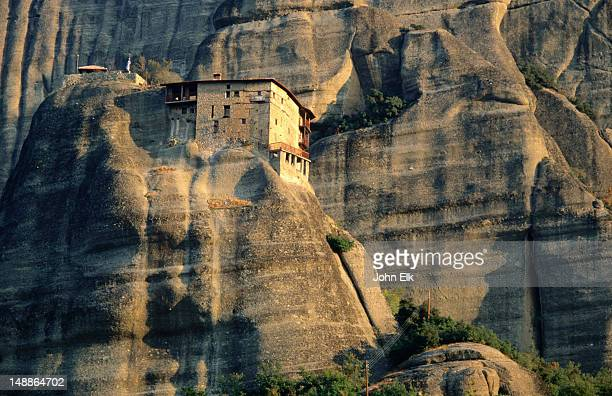View of the Agios Nikolaos Monastery nestled in the rocky cliffs of Meteora.