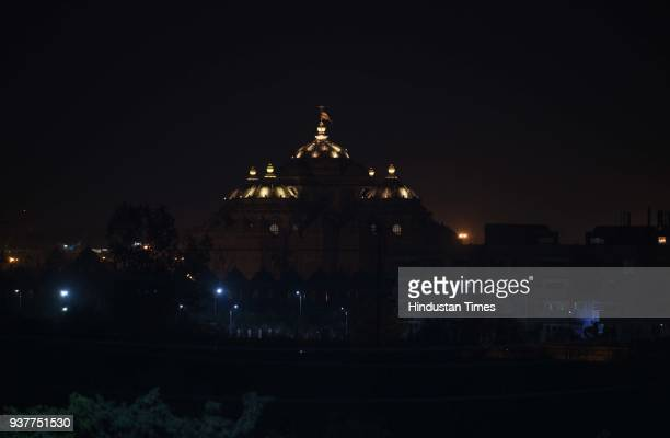 A view of the Akshardham Temple before its lights were switched off for an hour marking Earth Hour to save energy on March 24 2018 in New Delhi India...