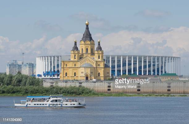 View of the Alexander Nevsky Cathedral and 2018 World Cup football stadium in Nizhny Novgorod across the Volga river, Russia.