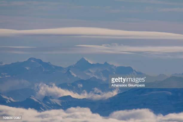 View of The Alps through airplane window on January 03 2019 in Zurich Switzerland The Alps are the highest and most extensive mountain range system...