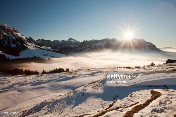 View of the Alpstein massif with Mt. Saentis and mountain pasture in the snow, Alpstein range, Swiss Alps, Switzerland