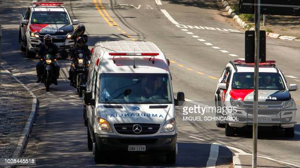 View of the ambulance transporting Brazilian rightwing presidential candidate Jair Bolsonaro as it arrives at the Albert Einstein Hospital in Sao...