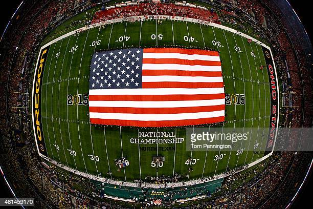 View of the American flag during the national anthem performed by Lady Antebellum prior to the College Football Playoff National Championship Game...