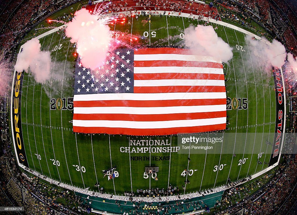 A view of the American flag during the national anthem performed by Lady Antebellum prior to the College Football Playoff National Championship Game between the Oregon Ducks and the Ohio State Buckeyes at AT&T Stadium on January 12, 2015 in Arlington, Texas.