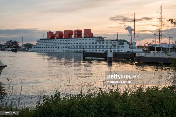 View of the Amstel Botel at dusk on April 19 2017 in Amsterdam Netherlands Amstel Botel is a 3star exclusive hotel moored at NDSM Pier It opened its...
