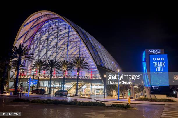 """View of the Anaheim Regional Transportation Intermodal Center illuminated blue with a sign reading """"Thank You #lLightItBlue"""" on April 16, 2020 in..."""