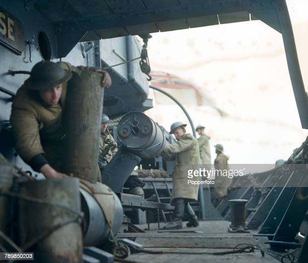 View of the anti submarine depth charge crew ready at their stations on the deck of a Royal Navy converted trawler on convoy patrol in the North Sea...
