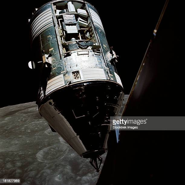 view of the apollo 17 command and service modules in lunar orbit. - space capsule stock photos and pictures