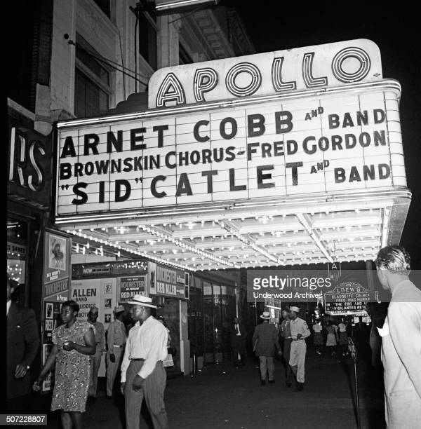 View of the Apollo Theatre marquee at night on West 125th Street in Harlem New York New YorK 1947