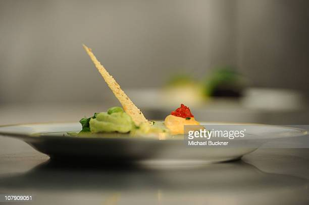 A view of the appetizer featuring grilled eggplant with edamame and red pepper hummus with marinated artichoke and arugula is shown at the Menu...