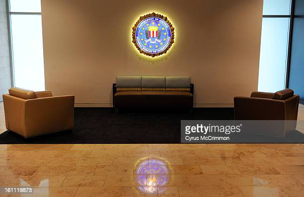 View of the architecture of the new FBI building at Stapleton in Denver on Friday July 23 2010 A employee commons area walkway with the FBI logo on...