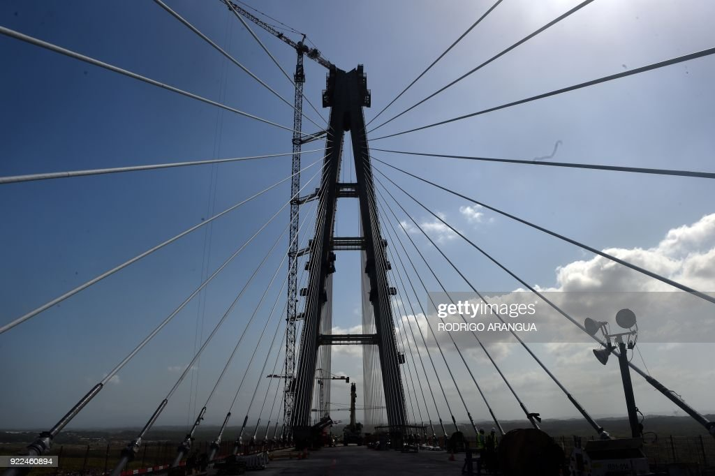 View of the Atlantic Bridge under construction over the Panama Canal in Colon, 80 km from Panama City, on February 21, 2018. /