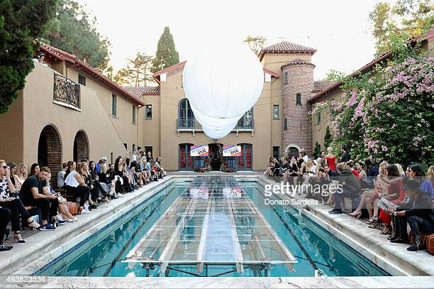 A view of the atmosphere at the REVOLVE fashion show benefiting Stand Up To Cancer on October 22 2015 in Los Angeles California