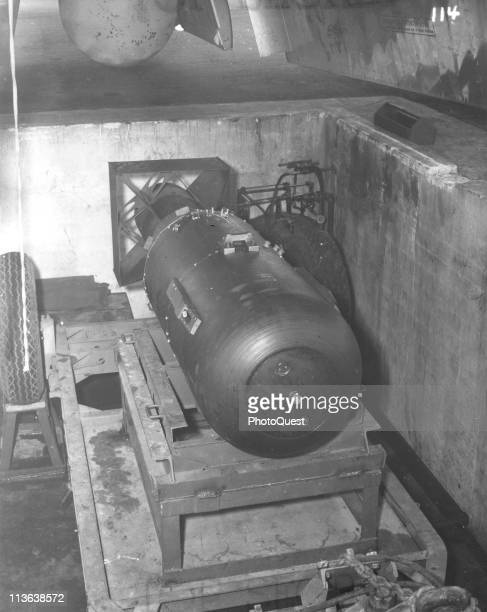 View of the atomic bomb codenamed 'Little Boy' as it sits on trailer cradle in a bomb pit on the North Field of Tinian airbase North Marianas Islands...