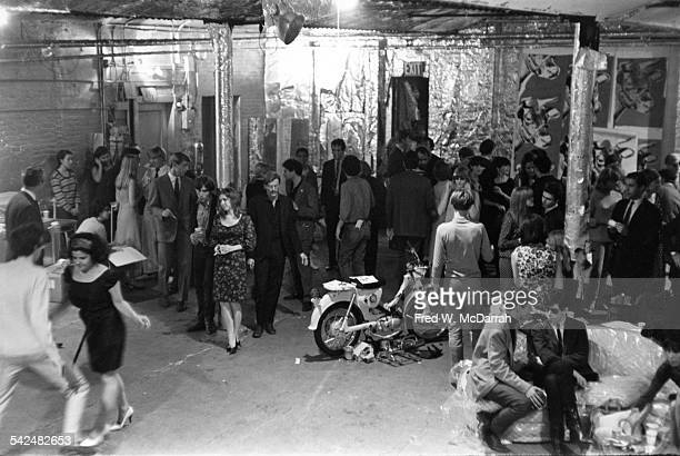 View of the attendees at a party in pop artist Andy Warhol's studio, the Factory , New York, New York, August 31, 1965. Among those pictured are...