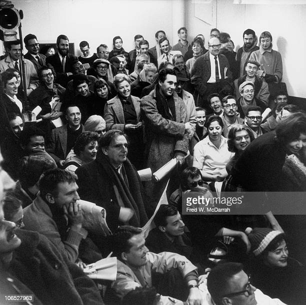 View of the audience as they attend a performance art piece entitled 'Ray Gun Specs' at the Judson Gallery New York New York March 1 1960 Among those...