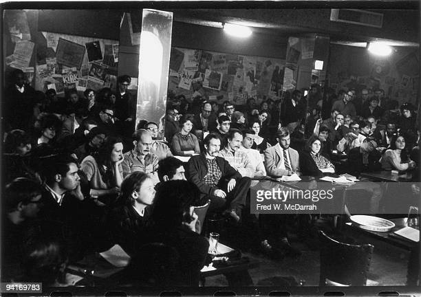 View of the audience as they listen to a poetry reading at the Five Spot Cafe New York New York February 22 1964 The reading a benefit for a theatre...
