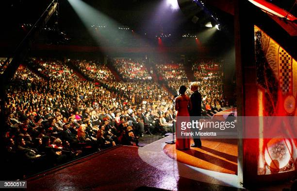 View of the audience watching Singer India Arie and NAACP Chairman of the Board Julian Bond on stage at the 35th Annual NAACP Image Awards held at...