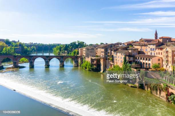 view of the august bridge and the saint cecile church in albi - midi pyrénées stock photos and pictures