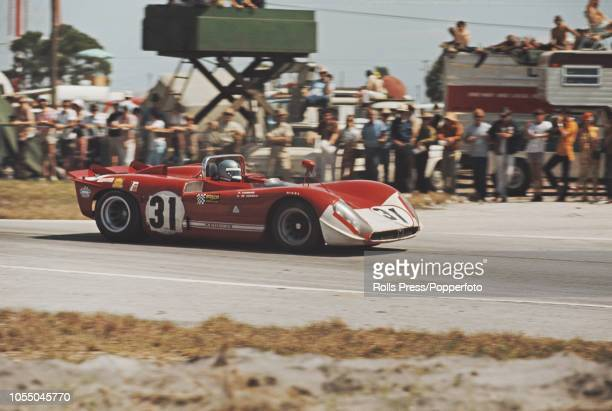 View of the Autodelta SpA Alfa Romeo T33/3 Alfa Romeo 3L V8 racing car driven by Piers Courage and Andrea de Adamich to finish in 8th place during...