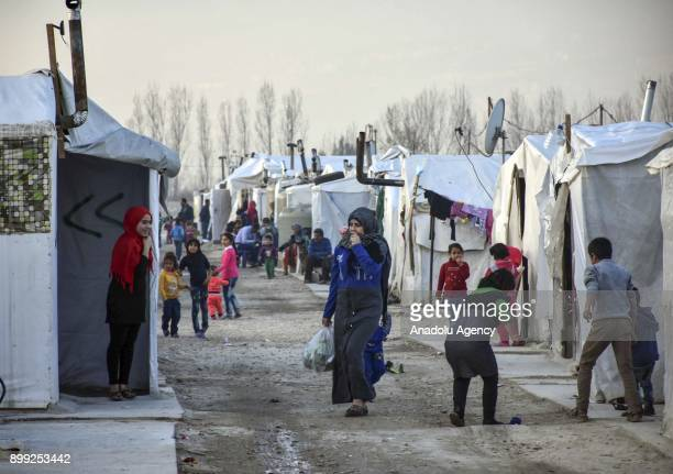 A view of the Awde refugee camp where can host around 2500 people with its' tents and prefabricated houses is seen as Syrian refugee children play...