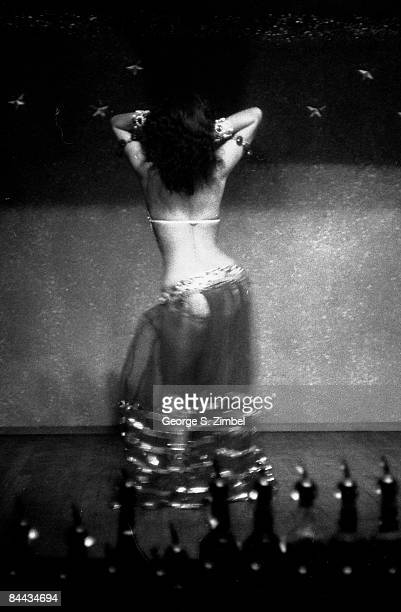 View of the back of Cubanborn Isabella Garcia better known as Chelo Alonso as she dances seductively at an unidentified New Orleans venue 1955 United...