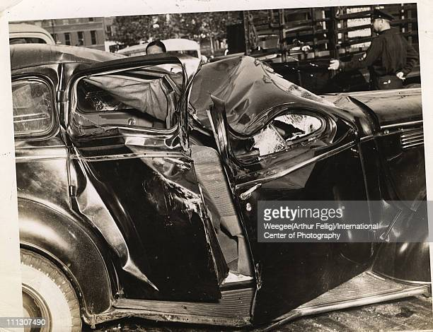 View of the badly dented roof of a car destroyed in an accident mid 20th century Photo by Weegee/International Center of Photography/Getty Images