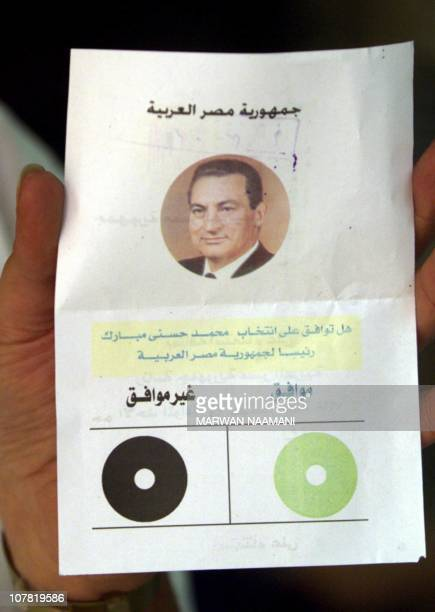 View of the ballot carrying a picture of Egyptian President Hosni Mubarak and a green circle for I agree and a black circle which says I do not agree...