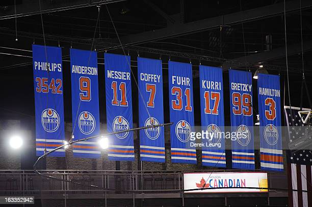 A view of the banners for radio broadcaster Rod Phillips and the retired numbers of previous Oilers players Glenn Anderson Mark Messier Paul Coffey...