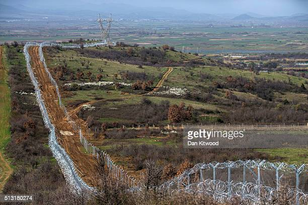 A view of the barbed wire fence along the GreekMacedonia border on March 01 2016 near Idomeni Greece The transit camp has become overcrowded as...