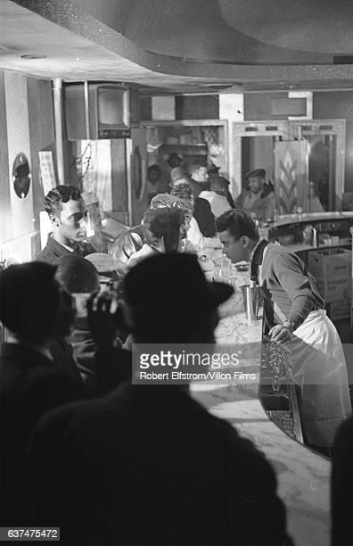 View of the bartender and various patrons at an unidentified Harlem bar New York New York 1964