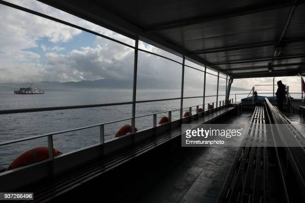 view of the bay from a passenger ferry,izmir. - emreturanphoto stock pictures, royalty-free photos & images